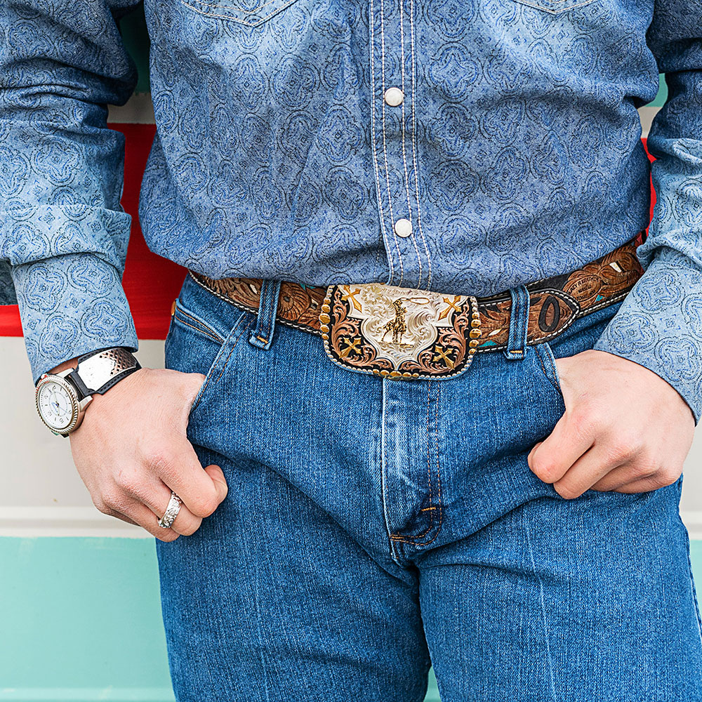 Faith in Four Buckles with a Roping Rider